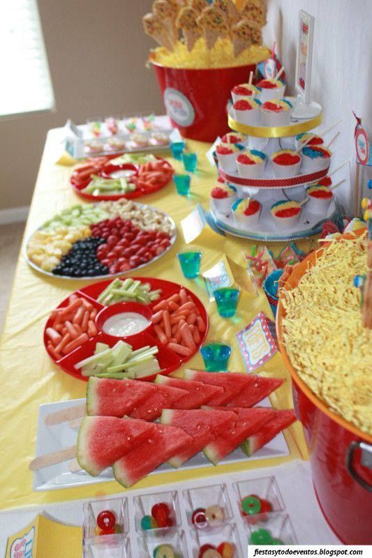 Pool party food table - love the watermelon on a stick