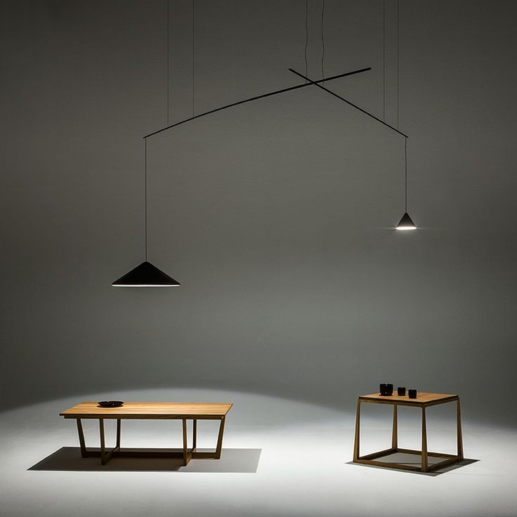 North hanging lamp designed by Arik Levy offer a surprinsing lighting effect by having the base and light source apart.