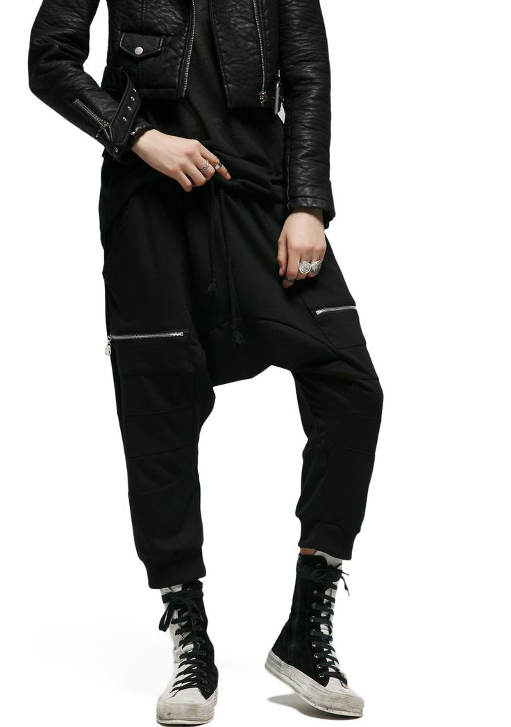 MNML Mob Mentality Dropcrotch Pants will throw the first punch, bb. Take to the streets in these sikk pants, featurin' a black paneled construction, drop crotch, banded trim, zippered utility pockets, and an elasticized drawstring waist that ya can pull up or slouch down.