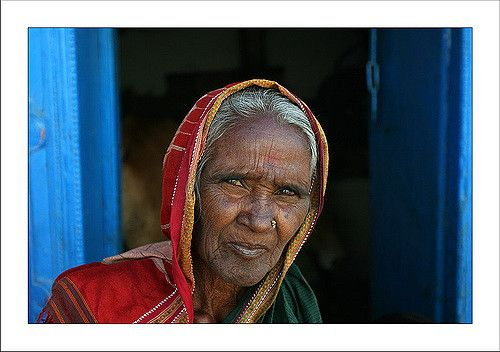 https://flic.kr/p/doxNh | Grandmother. Pattadakal | In the gate of her house's door, while her husband is feeding the cows. Here too, I did not come in the archeological perimeter, the village is so nice.