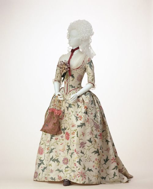 This gown's amazing floral silk material was hand painted in China in the 1760s. It was later imported to England where it was made into a Robe à l'anglaise circa 1785.