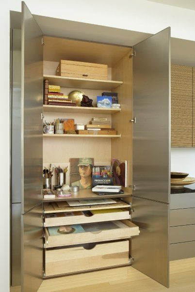 This Art Studio Stays Organized With Stainless Steel Slab Base Cabinets  With Complimenting Zebra Wood Wall
