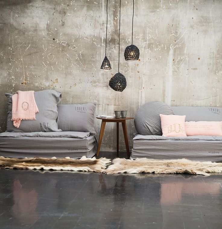 The natural texture of layered, crisp linens work to soften hard masculine lines and raw, exposed elements like concrete