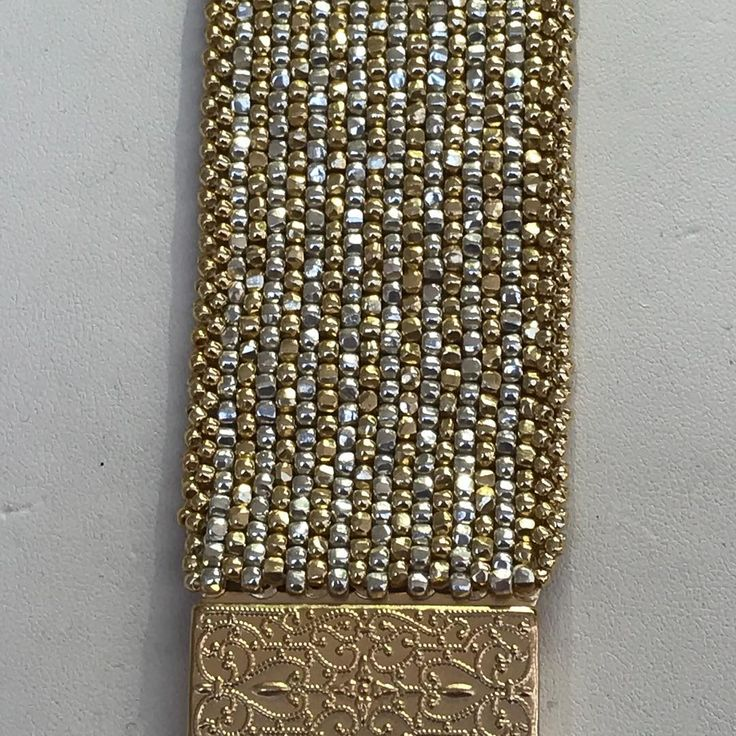 Holly's gorgeous peyote bracelet with 3 cut Beads!! I need these Beads!! #peyote #peyotestitch #beadweaving #beadweaver #tohobeads #seedbeads #glassbeads #silver #gold #silverandgold #goldandsilver #parkavebeads #handwoven #handweaving #handweaved #handmadejewelry