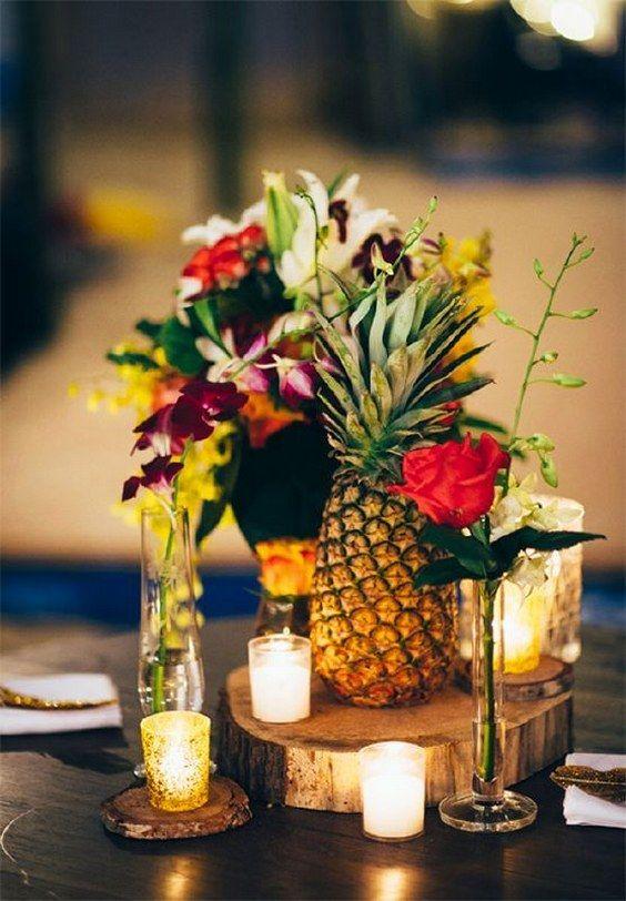 rustic pineapple wedding centerpiece / http://www.deerpearlflowers.com/fruit-wedding-ideas/