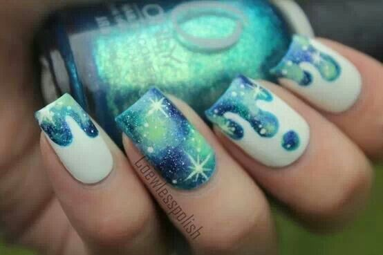 Drips of blue and green galaxy accent nail. Painted.
