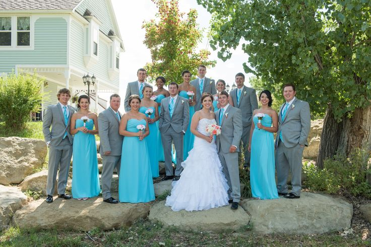 Malibu Blue/Gray/Coral Wedding - The malibu blue bridesmaids dresses looked WONDERFUL with the light gray tuxes. The long dresses are elegant on any body type!   Photo Credit: Whitney Bird Photography & Design  Venue: Chancey's Event Center