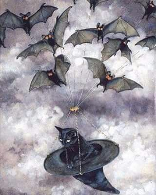 Bats pulling a black cat in a witches hat. What could be better than that?