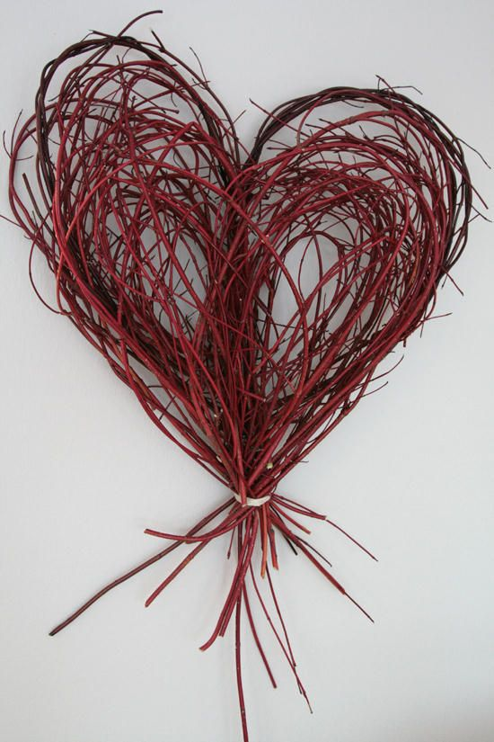 Using small long twigs to make a heart, paint them and you can put them anywhere!