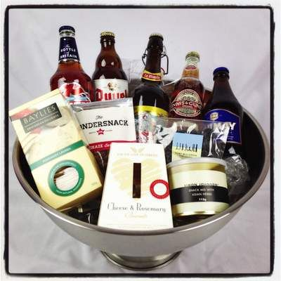 Beer & Nibbles, easy, to the point, he'll love it! $85 http://www.justcorporate.net.au/gifts/browse-by-style/beer/beer-nibbles/