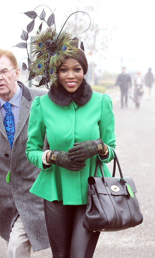 Top choice: On St Patrick's Thursday 2014, Ms Adams wore emerald, topped with a peacock feather hat