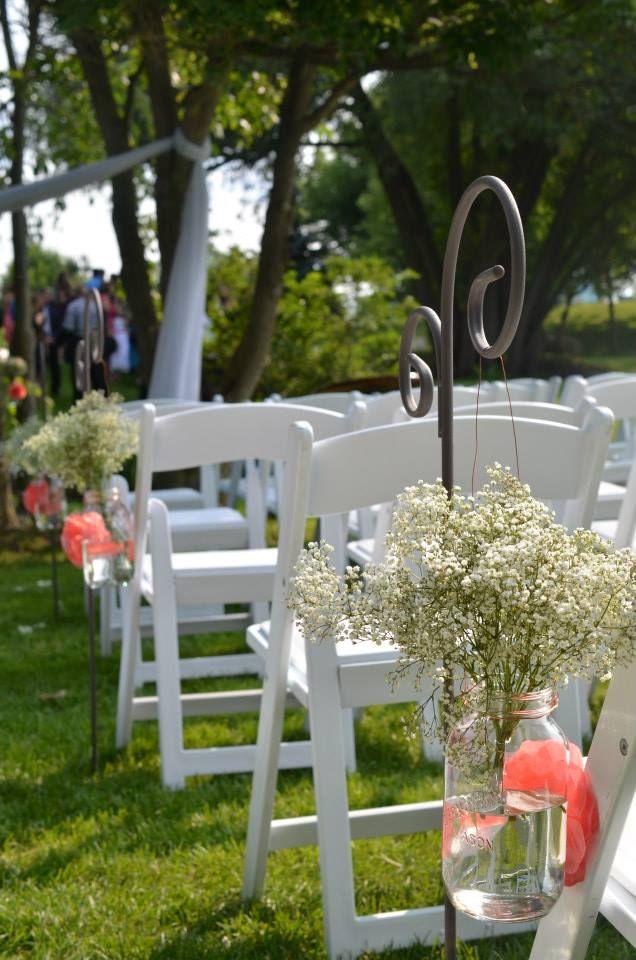 Outdoor wedding ceremony. Babies breath
