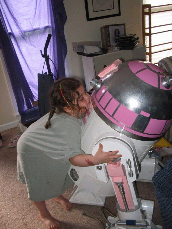 BB-8 won't be the only new astromech droid to grace screens around the world when Star Wars: The Force Awakens premieres on December 18. The beloved pink R2 unit, R2-KT, will also be making its live-action debut in the film. Eagle-eyed fans will remember that the colorful droid has appeared in the galaxy far, far away before, popping up in both the Clone Wars animated show, as well at the LEGO Star Wars: The Yoda Chronicles. Some may wonder why the inclusion of a pink R2 unit is all that…
