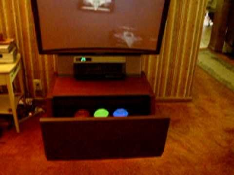 """Sony Videoscope KP-5040 1981 50"""" Projector TV - YouTube. Screen and projector combined by way of a retractable mirror."""