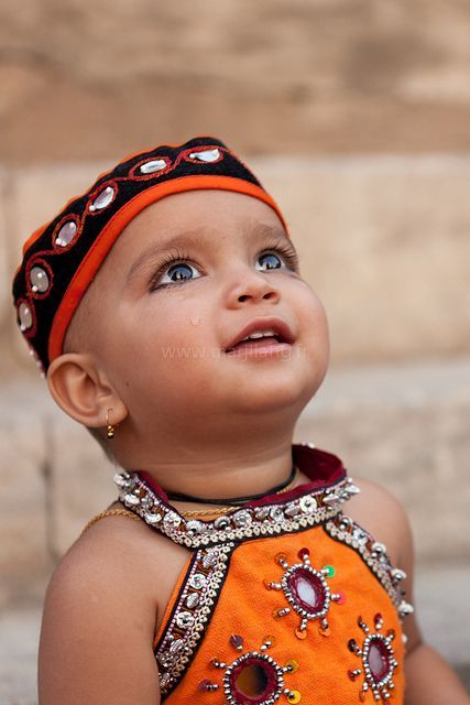 Beautiful photo of a child dressed in traditional clothing at the Gangaur festival, Udaipur, Rajasthan, India. Picture by Marji Lang.