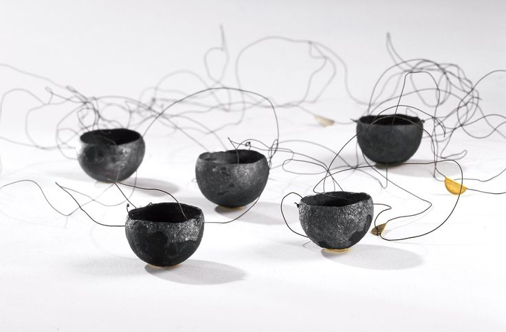 """""""Take out of the fire"""" by Kay Eppi Nölke. 1998-2004. Iron, filled with 5g 925 silver."""