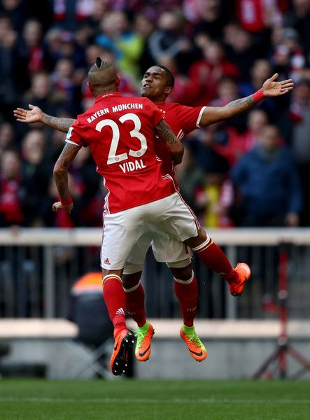Arturo Vidal #23 of Muenchen celebrate with team mate Douglas Costa after he scores the opening goal during the Bundesliga match between Bayern Muenchen and Hamburger SV at Allianz Arena on February 25, 2017 in Munich, Germany.