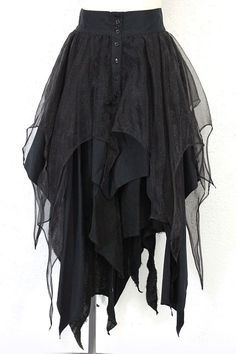 black layered witchy skirt for my Dohash?? I'm thinking yes. with some adorable pointed boots and a black veil with elbow length gloves and a corseted top with bubble sleeves?? possibility