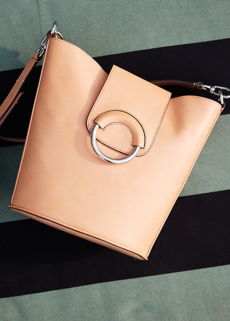 Each piece designed in fine Vachetta leather bears its own natural, individual markings and texture that become richer and more unique over time. This tan leather bucket bag is a stylish and practical everyday bag for spring | Banana Republic