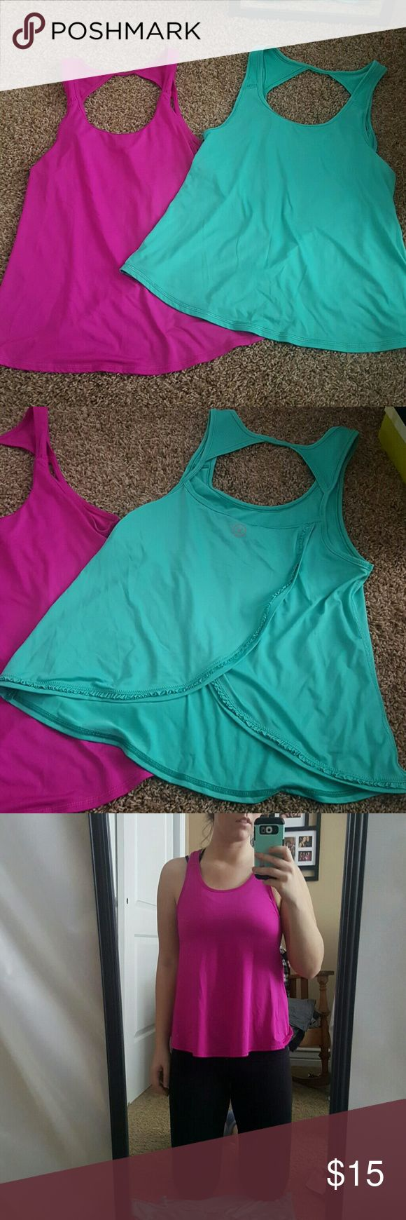 **Discounted Ship** 2 American Eagle work out tops Fushia pink and teal tanks. Exact same. The back is cut out, cute lacey detailing on the back. Flowy in the front. American Eagle Outfitters Tops Tank Tops