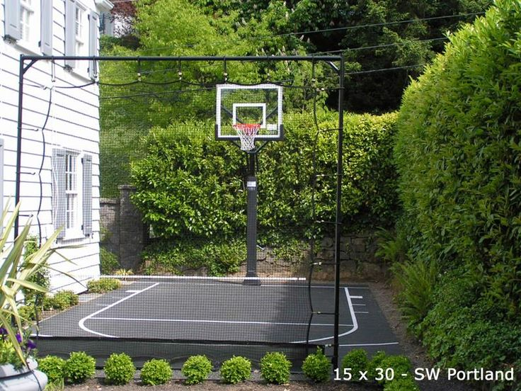 small side yard basketball court w boxwood and net