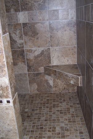 Small shower stall with a door less walk-in tiled shower