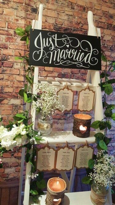 Table plan to hire, decorators ladder, rose garland, heart logs tea light holders, lace jam jars. Vintage rustic look