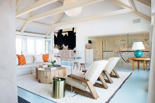 beach side living, blue floors, wood beams, stylish casual living room, design by David Netto