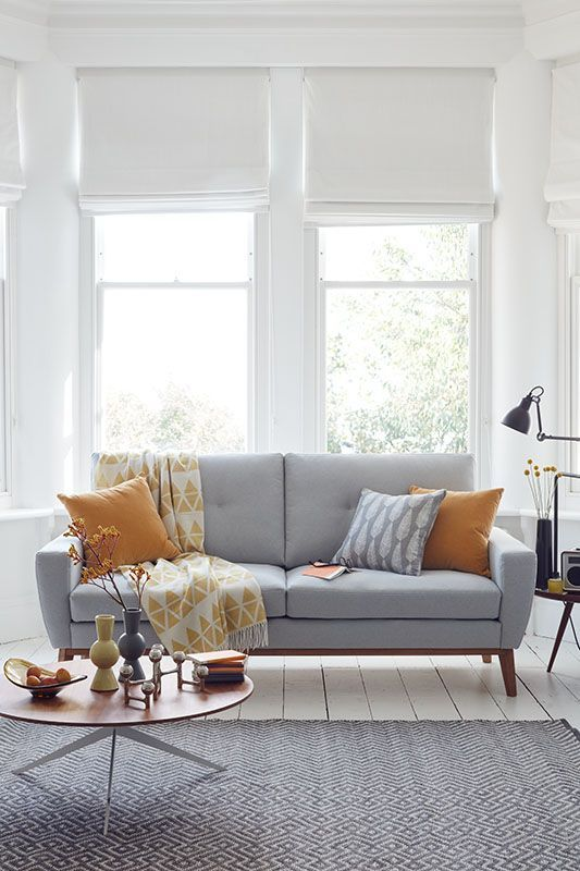 Instead of buying new furniture, always consider a simple hack of adding colorful cushions. They look fantastic on a neutral sofa. Just look at these few pillows that bring life to this space.
