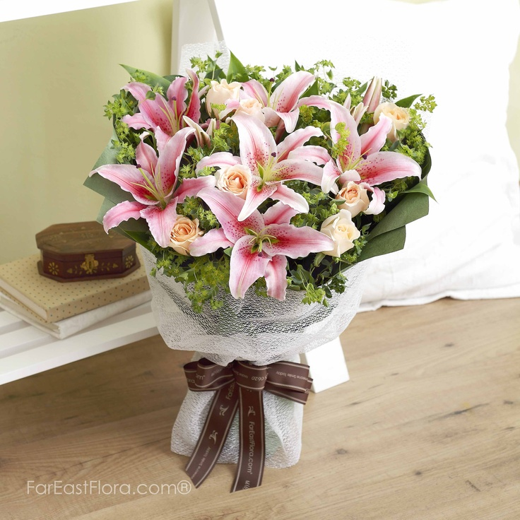 PT16 - My Acapulco  If you cannot head to the tropical resort in Southern Mexico, these Acapulco lilies by the same name are enough to put you in the mood for some R Exuberant and lively, these pink lilies and champagne roses will adore your company.