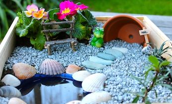 Make a fairy garden with kids.  I love this one with planter as home. A bucket filled with water. And pebbles and seashells for decorating.