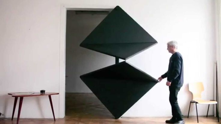 "Austrian artist Klemens Torggler. This 4-panel entryway called the Evolution Door opens and closes in a surprisingly elegant way at the slightest touch, folding in on itself like pieces of paper. Torggler calls this system a ""flip panel door"" (Drehplattentür)"