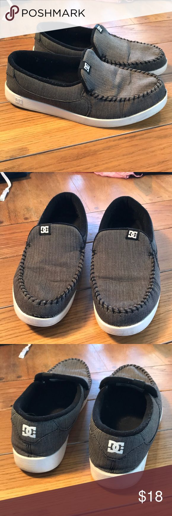 Men's DC Slip Ons Men's DC black and white size 13 slip ons. Has a spot where the fabric has separated from the rubber on toe, as seen in photo.          01/5 DC Shoe Shoes Loafers & Slip-Ons