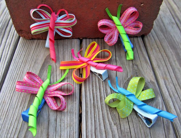 These insanely cute sculpted ribbon hair bows are created by SAHM Stuart Acrey, who, after making tons of bows for her daughter, Ellie, deci...