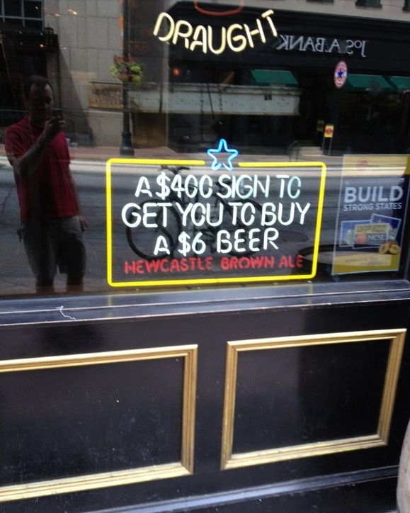 Well that puts things into perspective.   Frankly we have no idea what this sign is trying to convey but we laughed!