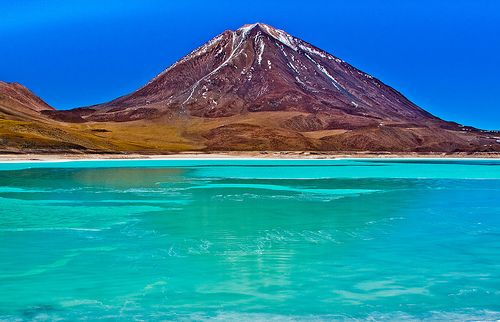 The giant salt water lake at 14,000 feet above sea level in the Atacama desert in Chile.  Natural hot springs pockets around the edges.