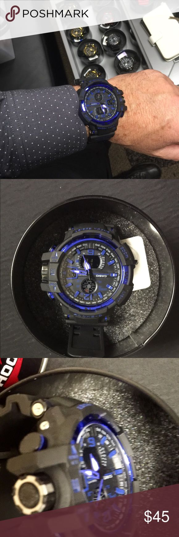 New G-Shock watch Last one at this price Includes Tin case and instructions guide  Price is discounted already and firm Item specifics Band Width: 20 -29 millimeters(mm)   Style: Sport   Dial Material Type: Plastic   Movement: Digital   Dial Window Material Type: Plastic   Feature: Multiple Time Zone   Dial Shape: Round   Band Material Type: PU   Model Number: GA100     Dial Display: Analog-Digital   Gender: Unisex   shock resist: yes Casio Accessories Watches