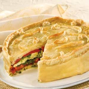 Torta Rustica, layers of cheese, eggs, meat and veggies, encased in puff pastry