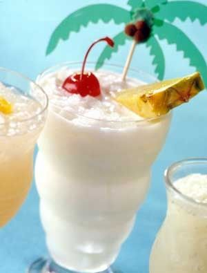 ChiChi  (1/4  cup vodka Mandrin Flavored  2  tablespoons cream of coconut 2  tablespooon pineapple juice   2  tablespoons sweet-and-sour drink mix 2  tablespoons half-and-half 1  tablespoon lime juice   Crushed ice Pineapple wedges   Maraschino cherries)