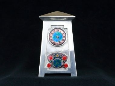 Tudric pewter and enamel timepiece of architectural form designed by Archibald Knox for liberty & Co. C 1905  In excellent condition with perfect enamel to the dial and front of the case