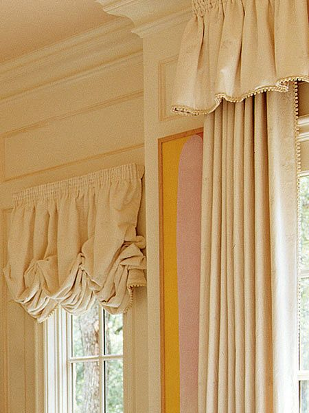 This elegant cream-colored window treatment gives the finishing touch to a refined bathroom. (Photo: Photo: Antoine Bootz and Jeff McNamara; Designer: Cathy Kincaid)