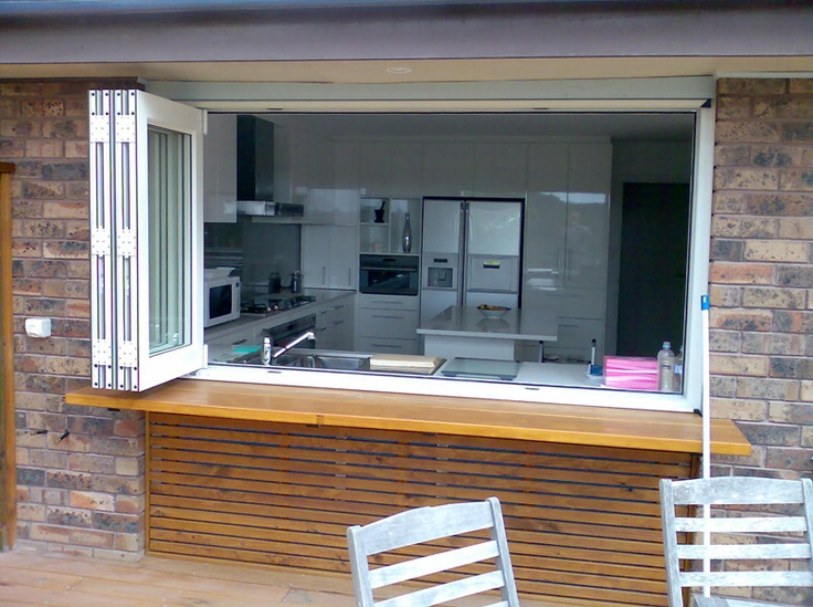 how awesome!!! just open some windows and your kitchen becomes part of your porch!! love it!