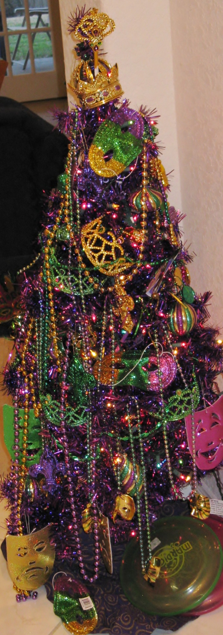Mardi Gras tree: Started with a purple foil tree with purple lights, added pgg lights, and just decorated it with balls, beads, masks, and rope.