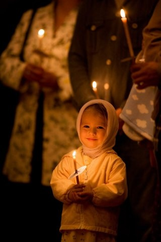 Russian children. Russian girl holding a candle in an Orthodox Christianity church. Russia. Beauty in nature. Photography.
