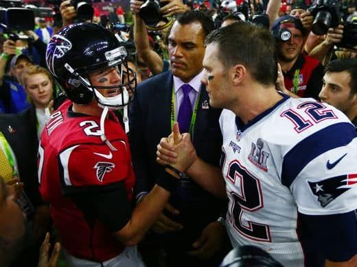 Patriots quarterback Tom Brady (12) shakes hands with - 2016 New England Patriots Super Bowl Championship