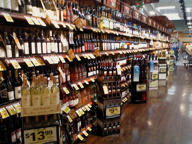 this is amazing  a liquor aisle in a supermarket  top shelf and all