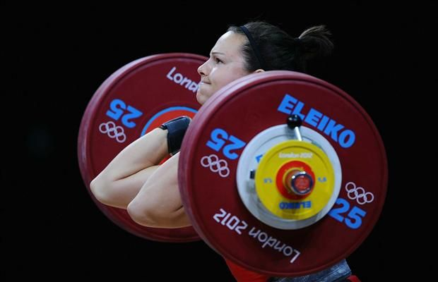 Christine Girard of Canada competes on her way to winning bronze during the Women's 63kg Weightlifting final on Day 4 of the London 2012 Olympic Games at ExCeL on July 31, 2012 in London, England.