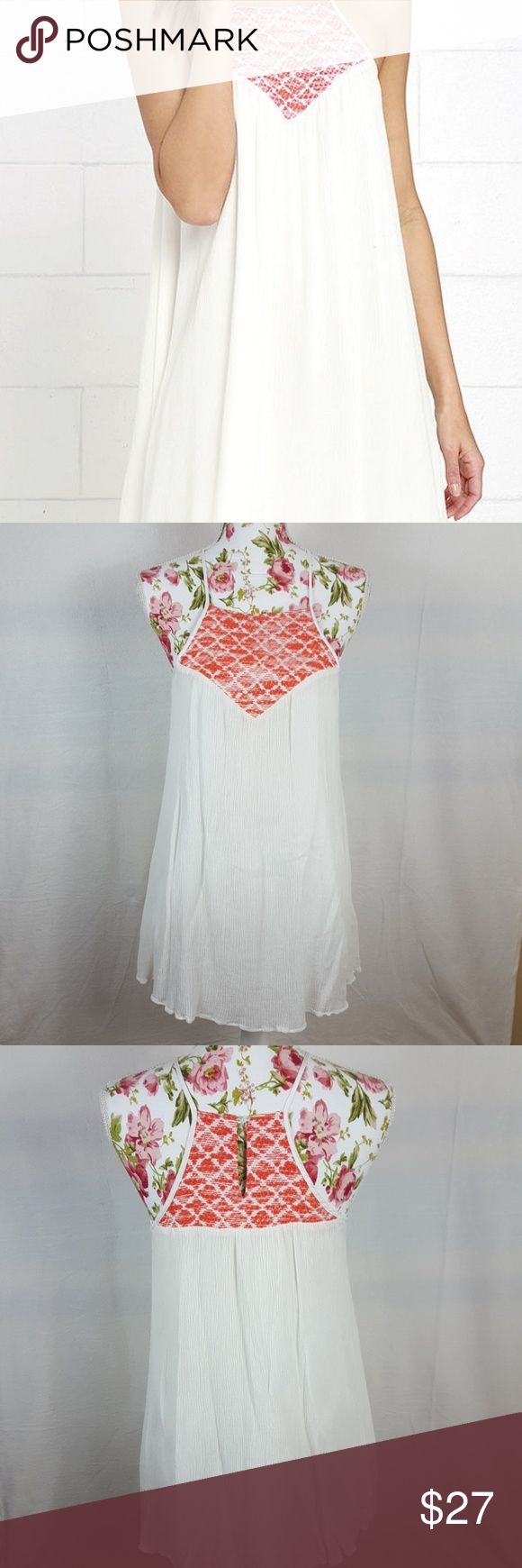 JACK BY BB DAKOTA Emberlynn Dress In Ivory DESCRIPTION  Breakaway from the everyday, and swing into the extraordinary Jack by BB Dakota Emberlynn Ivory Embroidered Dress! This adventurous rayon dress has a strappy apron neckline with vibrant coral embroidery front and back. Gauzy fabric carries into a playful trapeze silhouette. Back keyhole with top button. Euc.   Length: 33 inches from shoulder to hem BB Dakota Dresses