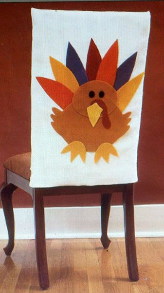 Thanksgiving chair covers  You could probably use the plain chair covers they sell at party city for this project instead of pillowcases.