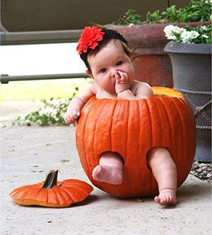 Aww....Baby in a pumpkin!